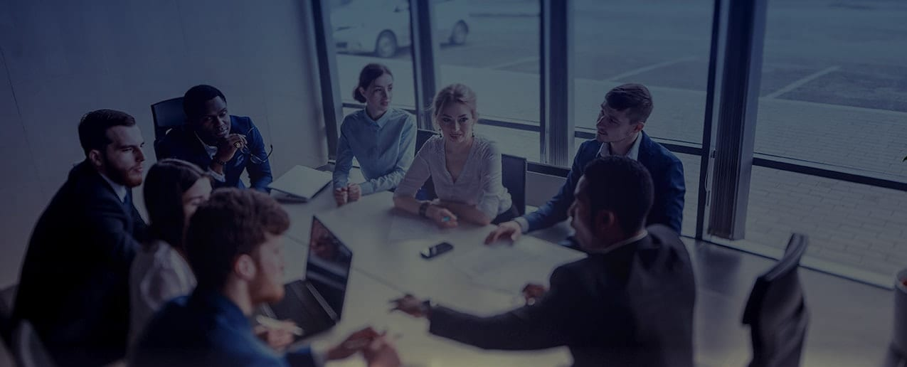 Business people sitting around a board table